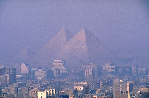 Giza pyramids over Cairo - Photo by Martin Gray - click photo for Sacred Sites Website